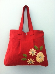 Red handbag with embroidery.