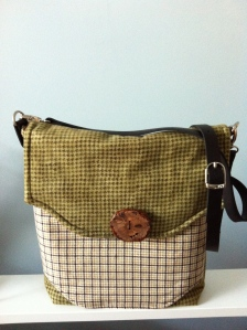Messenger bag with leather strap